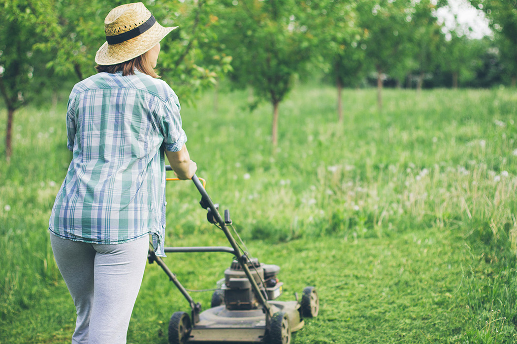 Woman mowing